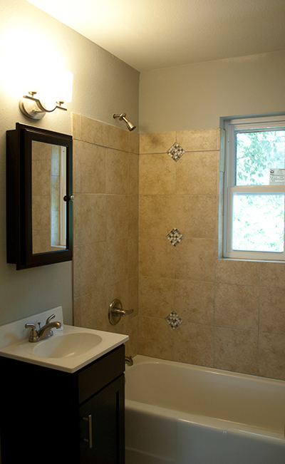 Bath tile accent above our recycled tubs are a Tony Thompson signature feature