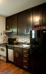 Grey Tone Kitchen with glass-top range, dishwasher & refrigerator included